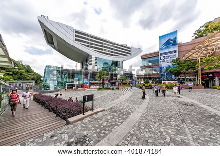 Hong Kong, China - August 22, 2011: View of Peak Tower at Victoria Gap. The Peak Tower is a leisure and shopping complex located at Victoria Gap, near the summit of Victoria Peak on Hong Kong Island.  - stock photo