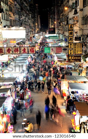HONG KONG, CHINA - DEC 25: Crowded people walk through the market on December 25, 2012 in Mong Kok, Hong Kong. Mong Kok, Hong Kong is the highest population density place in the world. - stock photo