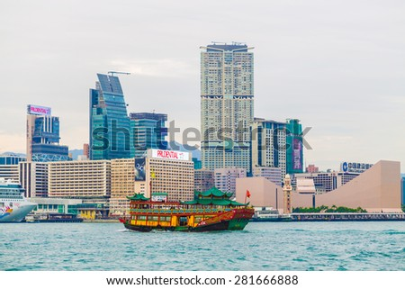 HONG KONG, CHINA - DEC 5: Old classic boat at  Victoria Harbour on December 5, 2014 in Hong Kong, China. With 7M population, it is one of the most dense areas in the world. - stock photo