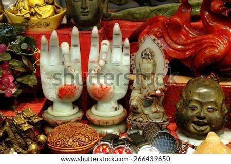 Hong Kong, China - December 17, 2005:  A variety of rare jade objets d'art are displayed at the famous Kansu Street Jade Market in Kowloon - stock photo