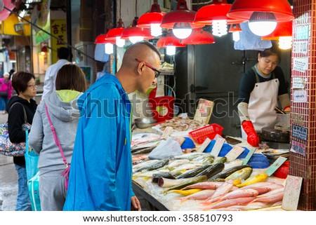 HONG KONG, CHINA - DECEMBER 14: Temple street in Hong Kong, China on December 14, 2015 Yau Ma Tei is the flea market located in the areas of Jordan and Yau Ma Tei in Kowloon