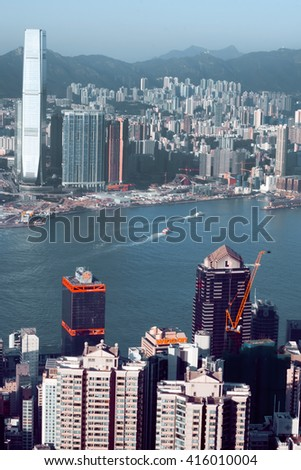 HONG KONG, CHINA - FEB 7: Cityscape of Hong Kong with waters of Victoria Harbor at sunset on February 7, 2016. There are 1,223 skyscrapers in Hong Kong.