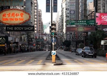 HONG KONG, CHINA - FEB 7: Crosswalk on the background of skyscrapers on February 7, 2016. More than 47 million tourists visit Hong Kong annually.