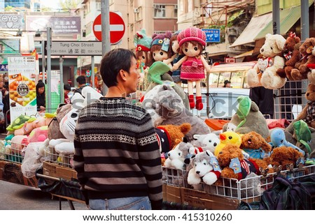 HONG KONG, CHINA - FEB 8: Man sells Chinese  soft toys in the street on February 8, 2016. More than 47 million tourists visit Hong Kong annually. - stock photo