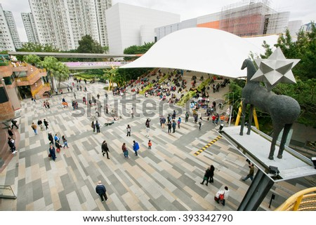 HONG KONG, CHINA - FEB 10: Many people and families relaxing and listening street music on a square during holidays on February 10, 2016. There are 1,223 skyscrapers in Hong Kong. - stock photo