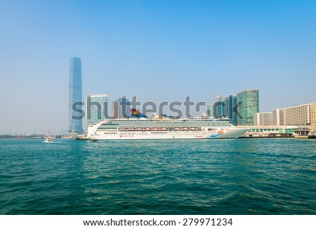 HONG KONG, CHINA - 18 JAN 2015: A luxury cruise liner, the Superstar Virgo from Star Cruises, moored and waiting for passengers at the central pier in Kowloon.