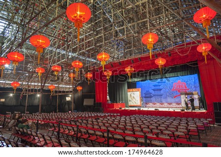 HONG KONG , CHINA - JAN. 26 : West Kowloon Bamboo Theatre on Jan. 26 , 2014 in Hong Kong. This temporary theatre is made of bamboo and for traditional Chinese opera during the Chinese New Year.  - stock photo