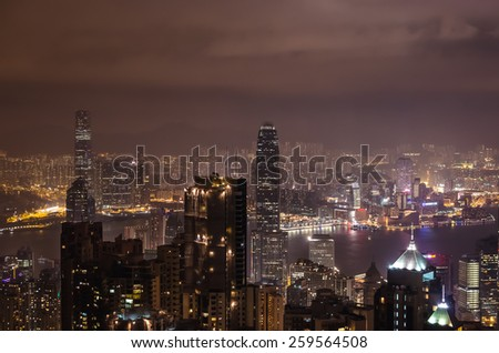 HONG KONG, CHINA - JANUARY 28: Night view of Hong Kong cityscape from Victoria Peak with highest skyscrapers illuminated by lights over water in Victoria Harbor on January 28, 2013 in Hong Kong, China