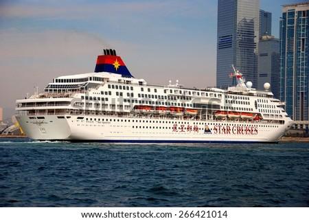Hong Kong, China - January 3, 2009:  Star Cruises Aquarius ocean liner cruise ship heading to its docking berth at Harbor City in Kowloon  * - stock photo