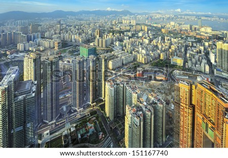 HONG KONG, CHINA - JULY 8: Ariel view of Hong Kong city on July 8, 2013. Hong Kong is one of the world's leading international financial centers and has a major capitalist service economy.  - stock photo