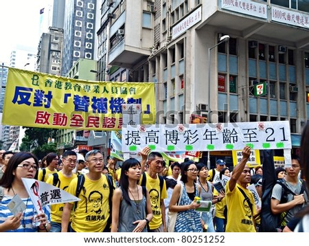 HONG KONG, CHINA - JULY 1: Hong Kong citizens/ people participated in the annual July 1 March demand for democracy and ban gambling from the government on July 1, 2011 in Hong Kong, China