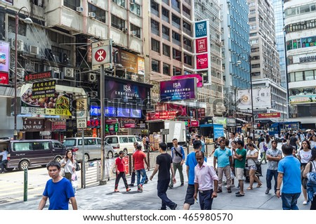 Hong Kong, China - July 4th. 2016 - Tourists and locals walking in the downtown Hong Kong in China.