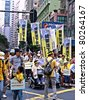 HONG KONG, CHINA - JULY 1: Unidentified Hong Kong citizens participate in the annual July 1 march to demand democracy and cross-border childbirth from the government on July 1, 2011 in Hong Kong, China. - stock photo