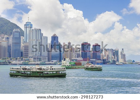 Hong Kong, China - June 3, 2015: Cityscape of Hong Kong, the view of the Victoria Harbour and ferries during daytime.