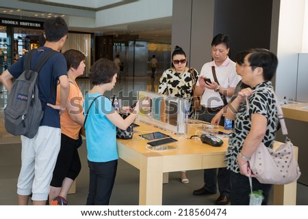HONG KONG, CHINA - JUNE 18, 2014: Shoppers in Apple store in Hong Kong. Store is in a shopping center IFC Mall, it is very popular with locals and tourists visiting Hong Kong. - stock photo