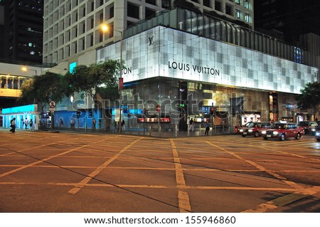 HONG KONG, CHINA - JUNE 08: Taxi drivers goes by the Causeway bay at night on June 08, 2012. Causeway bay is the most expensive shopping street of Hong Kong.  - stock photo
