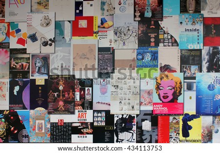 Hong Kong, China - March 15, 2014:posters and illustrations on the wall of a residential building in Hong Kong
