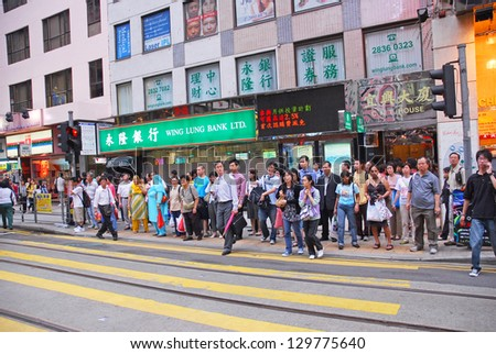 HONG KONG, CHINA-Â?Â?MAY 23:  Office people and shoppers congest Johnston Road. This area is internationally famous for business, finance and shopping. May 23, 2007 in Hong Kong, China - stock photo