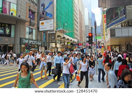 HONG KONG, CHINA�MAY 25: Office people and shoppers congest Queen Road Central. The most populated area in the world with 2 million people 47 sq/Km. May 25, 2007 in Hong Kong, China