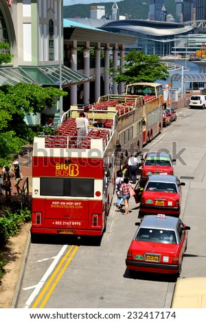 HONG KONG/CHINA - MAY 25: Touristic Buses and taxis in downtown Hong Kong on May 25 2014. Hong Kong is one of the most desired touristic destination in the far east. - stock photo