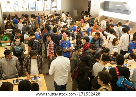 HONG KONG, CHINA - NOVEMBER 11, 2012: Buyers and shop assistants at Apple store in Hong Kong. Store is in a shopping center IFC Mall, it is very popular with locals and tourists visiting Hong Kong. - stock photo