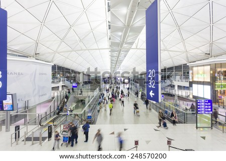 Hong Kong, China - November 29, 2013: Travelers walking in the Hong Kong International Airport.  - stock photo
