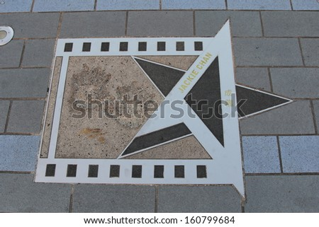 HONG KONG, CHINA - OCT 31: Famous palm print of Jackie Chan on the Avenue of Stars on October 31, 2013 in Tsim Sha Tsui, Hong Kong. The Avenue of Stars modeled on the Hollywood Walk of Fame. - stock photo