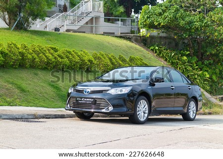Hong Kong, China Oct 27, 2014 : Toyota Camry Hybrid 2014 test drive on Oct 27 2014 in Hong Kong. - stock photo