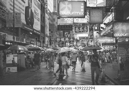 Hong Kong, China - October 03, 2015 : Many people in Mongkok street. Mongkok is characterized by a mixture of old and new buildings with shops and restaurants at street level. Monochrome photo,