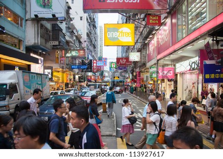 HONG KONG, CHINA - SEPTEMBER 14: Street view with traffic and shops on September 14, 2012 in Hong Kong, China. it is one of the most dense areas in the world.