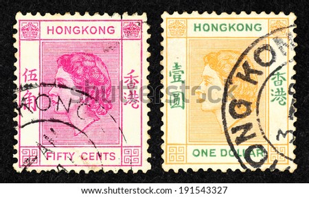 HONG KONG - CIRCA 1954: A pair of colorful postage stamp printed in Hong Kong with image of Queen Elizabeth II head.
