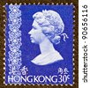 HONG KONG - CIRCA 1973: A stamp printed in Hong Kong shows Queen Elizabeth II, circa 1973. - stock photo