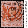 HONG KONG - CIRCA 1982: A stamp printed in Hong Kong shows Queen Elizabeth II with a traditional Chinese dragon and  a British lion on both side, circa 1982 - stock photo