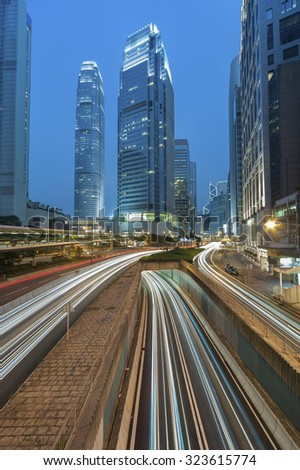 Hong Kong city at dusk with busy traffic - stock photo