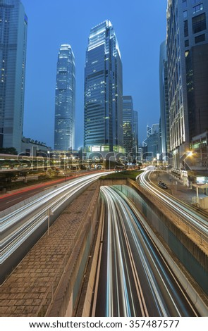 Hong Kong city at dusk with busy traffic