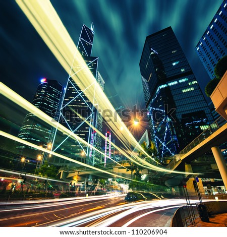 Hong Kong City center at night with light trails - stock photo