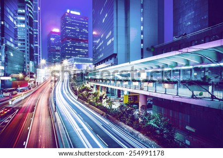 Hong Kong city motion blurred for background , with color tone tuned ,high key - stock photo