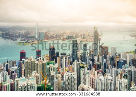 Hong Kong city with cloudy sky. - stock photo