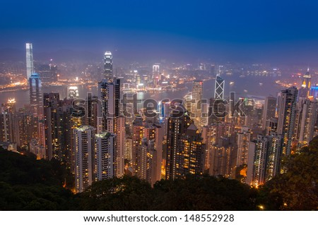 Hong Kong Cityscape at night from The Peak. Good for tourism - stock photo