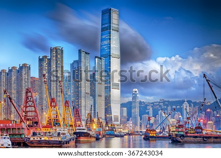 Hong Kong cityscape harbor view at sunset - stock photo