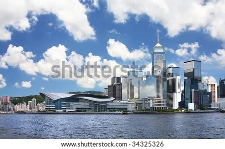 Hong Kong Cityscape. Hong Kong cityscape with Hong Kong Convention and Exhibition Centre located at the left and skyscrapers at the right. - stock photo