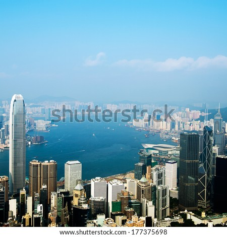 Hong Kong cityscape with victoria harbour and large group of tall buildings. - stock photo