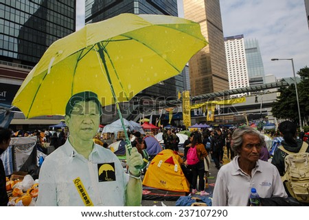 HONG KONG, DEC. 11. 2014: Chinese president Xi Jinping picture with umbrella among Pro-democracy supporters, at the Central district, as today is the last day of the protest. - stock photo
