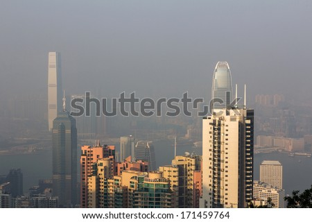 HONG KONG - DEC 22, 2013: Hong Kong Skyline View from Victoria Peak. Air pollution has become a huge problem in Hong Kong.