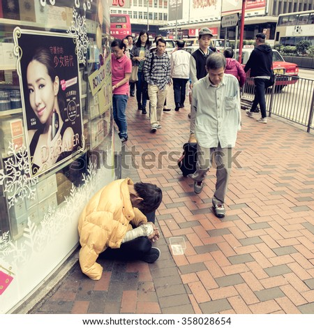 HONG KONG - DECEMBER 14, 2015 :Chinese beggars to beg for money on the overpass in Jordan district  Hong Kong. - stock photo