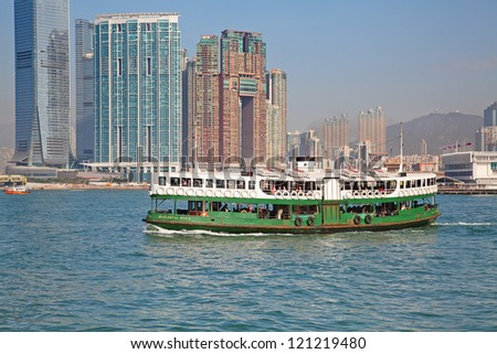 "HONG KONG - DECEMBER 3: Ferry ""Celestial star"" leaving Kowloon pier on December 3, 2010 in Hong Kong.Ferry is in operation in Victoria harbor for more than 120 years and is one of tourist attractions. - stock photo"