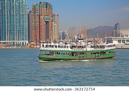 "HONG KONG - DECEMBER 3: Ferry ""Celestial star"" leaving Kowloon pier on December 3, 2010 in Hong Kong, China. Ferry is in operation for over 120 years and it is tourist attractions of the city. - stock photo"
