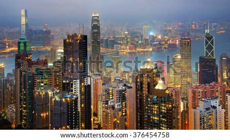 HONG KONG - DECEMBER 14, 2012: Hong Kong skyline from Victoria Peak at night. Victoria Peak is a major tourist attraction that offers views over Central, Victoria Harbour and Lamma Island.
