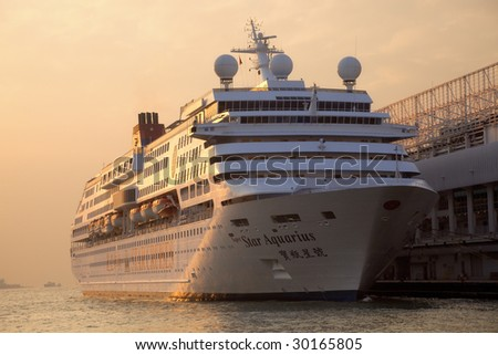 HONG KONG - DECEMBER 23: The Star Aquarius, first class ship of Star Cruises, is ready for the next World Tour and docked on December 23, 2008 at Ocean Terminal in Victoria Harbor, Hong Kong. - stock photo
