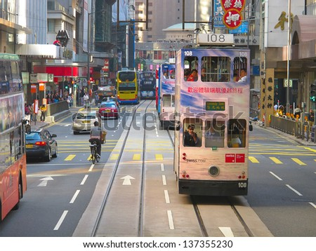 HONG KONG - DECEMBER 05: Unidentified people using city tram in Hong Kong on December 05, 2010. Hong Kong tram is the only system in the world run with double deckers.